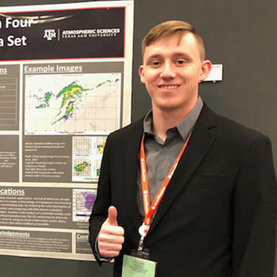Tyler Fenske and his research poster.