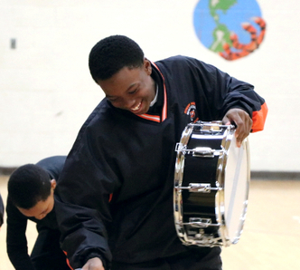Dr. Martln Luther King Jr. Elementary School drumline and flag corps (Project FOCUS Muskegon Heights)