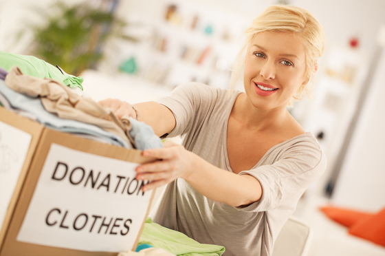 Woman donates clothes to charity.