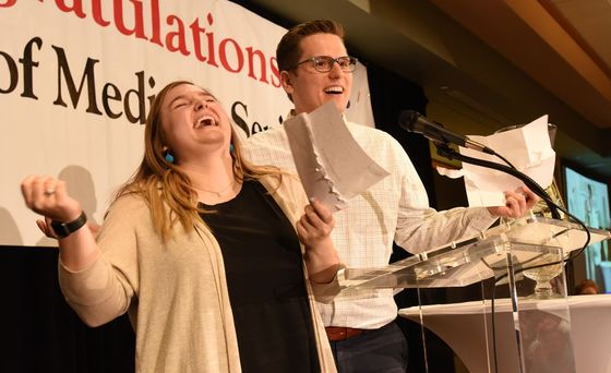 Tess Coker and Alex Croft react with joy after revealing to the crowd gathered for Match Day that they both will be completing their residencies at Indiana University School of Medicine in Indianapolis – her in pediatrics and him in emergency medicine. The couple, who met the first day of med school, said they were 'super nervous' coming into Match Day, but after learning of their matches, 'couldn't be more happy.' A total of 155 students from this year's graduating medical school class participated in this year's Match Day.