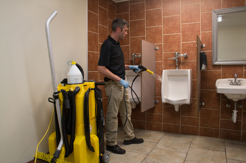 Cleaning a urinal with a Kaivac No-Touch Cleaning system.