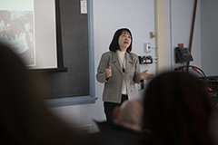 Ms. Chen Zhao gives a presentation.