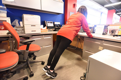 Desk push-ups- Place your palms on your desk and lean forward and then press your body up. Need it to be harder? Straighten yourself out more.
