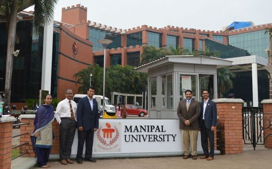 Assistant professor Naveen Nagaraj, Ph.D., (third from left) Amyn Amlani, Ph.D., chair of the Department of Audiology and Speech Pathology (second from right) and Samuel Atcherson, Ph.D., director of Audiology, (right) are exploring ways that the department might partner with India's Manipal Academy of Higher Education, formerly Manipal University.
