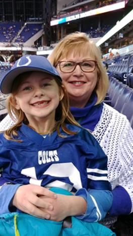 Donna Amrhein and her grandchild
