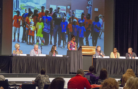 A panel of AR SAVES stroke survivors discuss their experiences during the Telestroke Conference in May in Hot Springs as a slide show behind them illustrates their stories and the history of the program.
