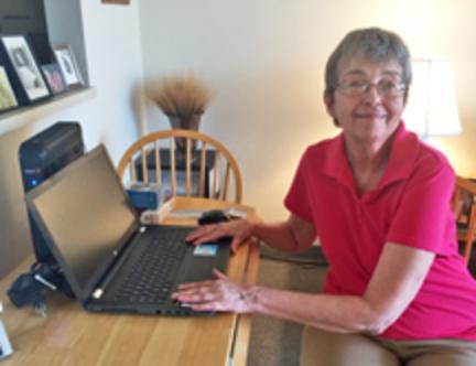 Christine Walsh enjoying her new laptop computer.