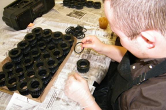 Individual at work assembling parts.