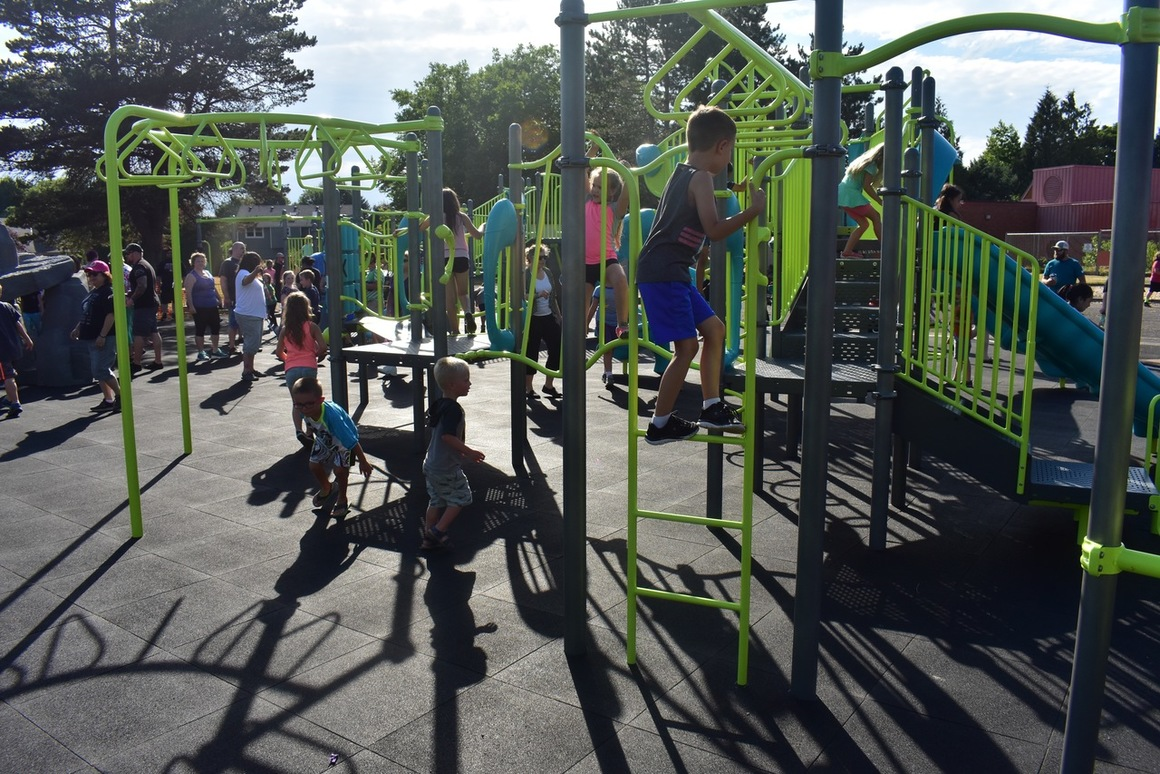 Image shows students enjoying new playground at Hollydale Elementary