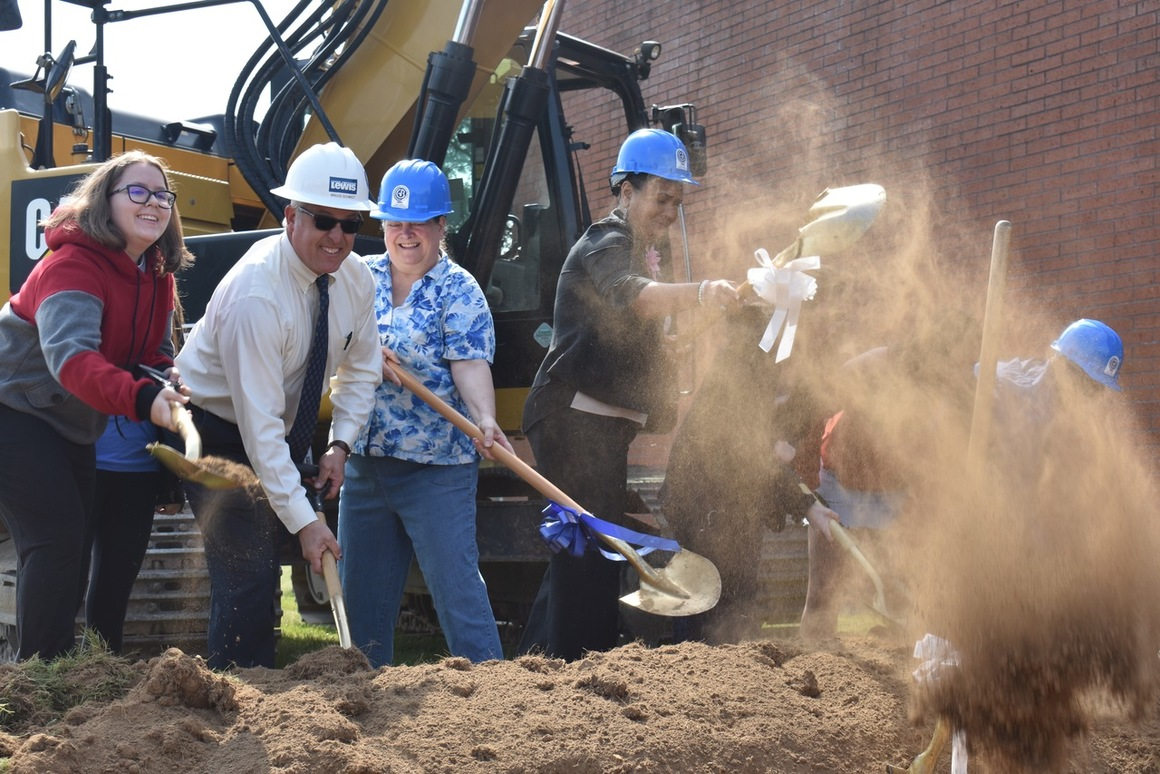 Image shows students and administrators participating in groundbreaking ceremony at Barlow High School this June.