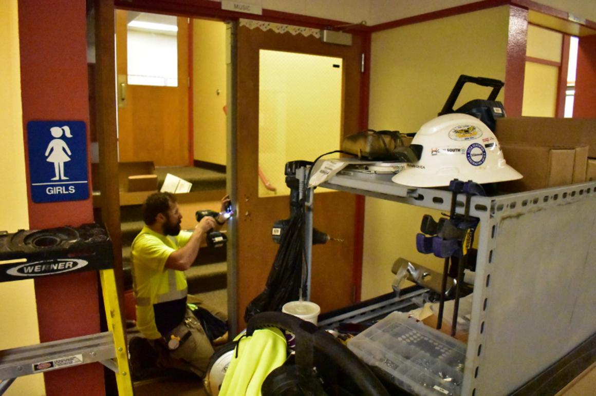 Image shows construction crews installing new, internally locking doors at Powell Valley Elementary School