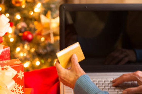 A woman shops safely at her computer on Cyber Monday