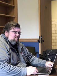 Jake Harrison sitting at his computer