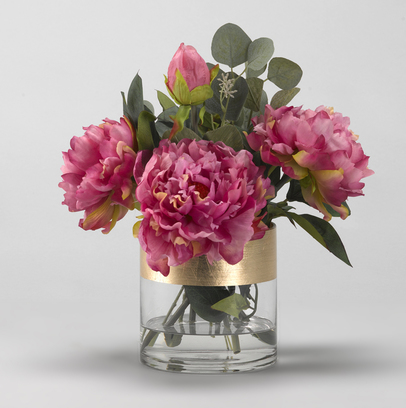 Pink peonies in glass cylinder