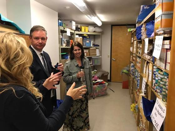Superintendent Anderson and Principal speak to a parent in the food pantry organized by parents at Crest View Elementary School