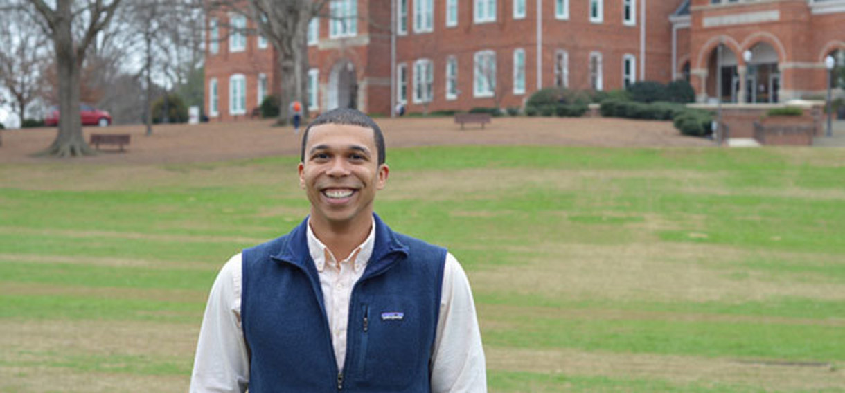Chris Normon pictured on Bowman Field in front of Tillman Hall.