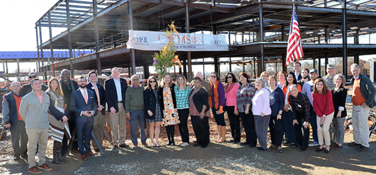 Group photo from Topping Out ceremony for new College of Business building.