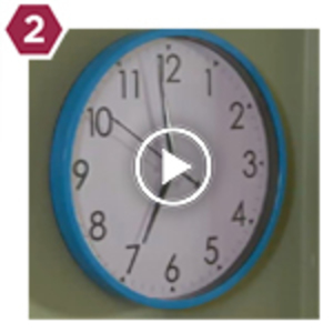 Clock with Play button for video