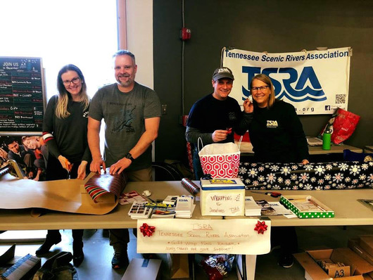 Four TSRA members wrapping gifts at REI-Brentwood, December 2018