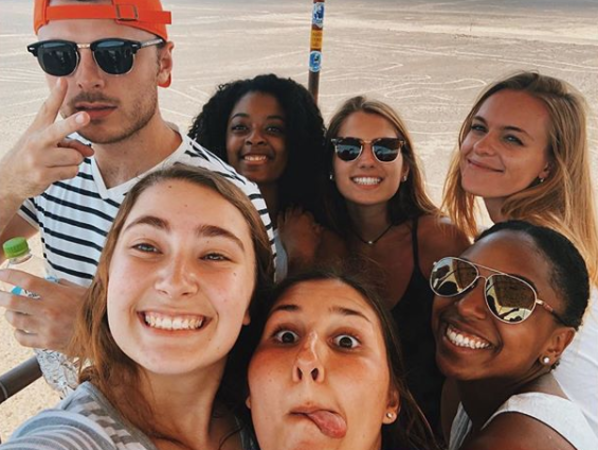 7 Miami students taking a selfie during their study abroad program in Peru