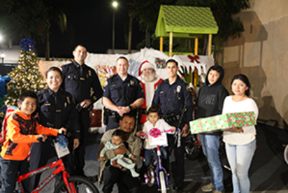 Long Beach Police giving out Christmas Gifts donated bt Gulfstream