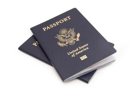 two USA passports on a white background