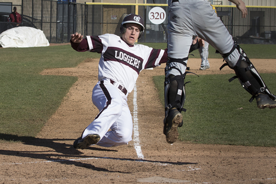 Logger baseball player slides into home base