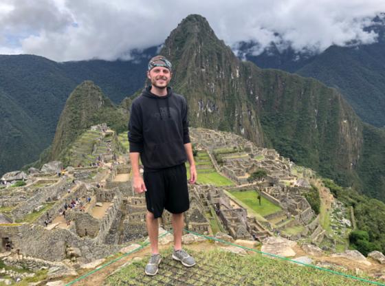 Jake Jones standing in front of Machi Pichiu