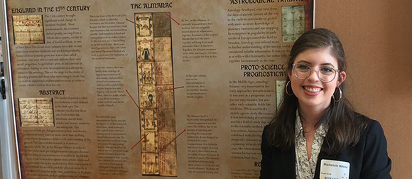 Mackenzie in front of research poster