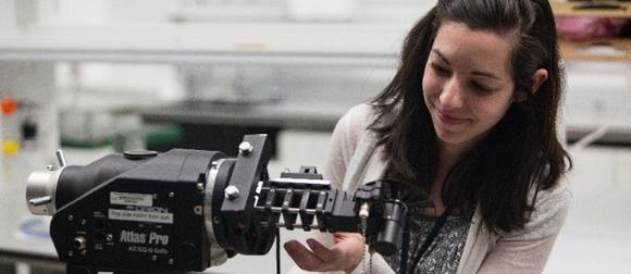 girl working scientific equipment