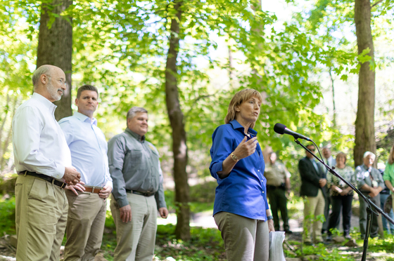 Secretary Dunn, Gov. Wolf and others speak about imporvemnets at the Glen Onoko trail head in the woods