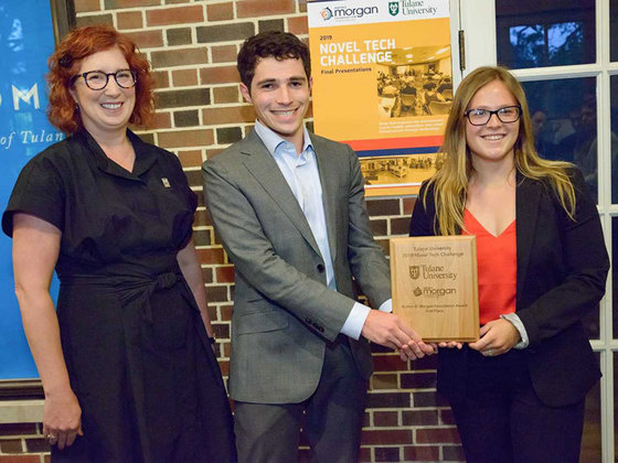 Benjamin Knapp (center) and Hannah Eherenfeldt (right), pictured with School of Science and Engineering Dean Kimberly Foster (left) won this year's Novel Tech Challenge for creating a medical simulation startup called ReSuture.