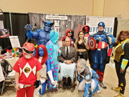 Participants from Ken-Ton Respite, including: Zack (Red Power Ranger), Michael (Captain America) and Natalie (Sully from Disney's Monsters Inc.), alongside staff members Ken, Marisol (not pictured) and Angelica (Mystique from the X-Men comic books).