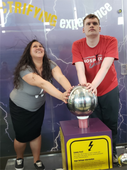 Participant Michael alongside instructor Marisol having fun with static electricity.