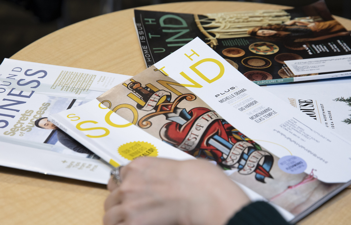 Issues of South Sound Magazine and South Sound Business Magazine on a table