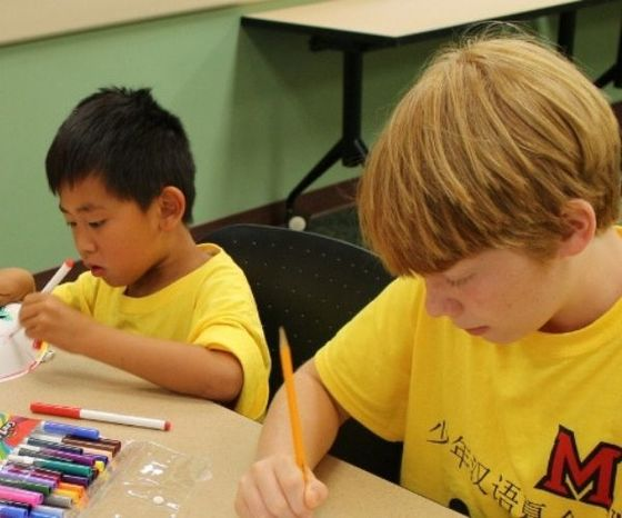 two children working on arts and crafts