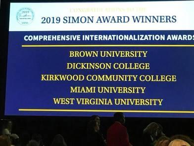 "Sign that says ""2019 Simon Award Winners, Comprehensive Internationalization Awards, Brown University, Dickinson College, Kirkwood Community College, Miami University, West Virginia University"""