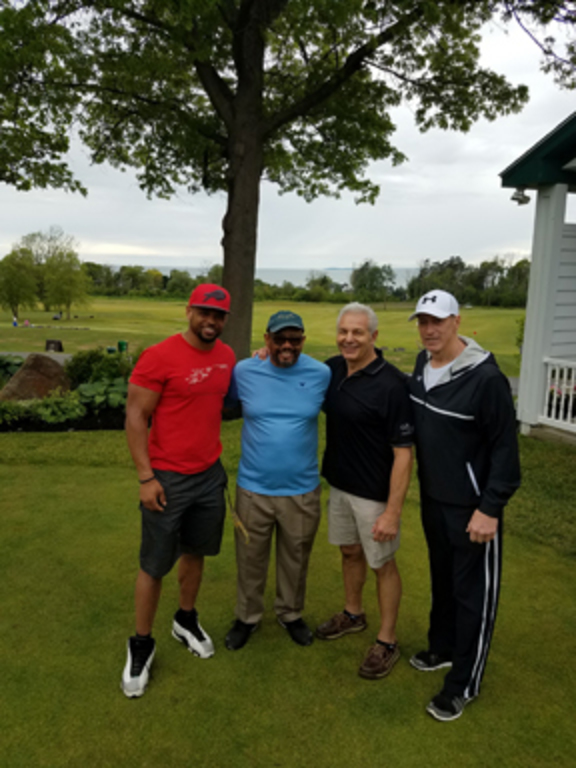 Pictured from left to right: Lorenzo Alexander of the Buffalo Bills; Brad Watts, People Inc. community relations coordinator; Dennis DiPaolo, owner of Ilio DiPaolo's Restaurant and Banquet Facility; and Jim Kelly, Hall of Fame quarterback for the Buffalo Bills.