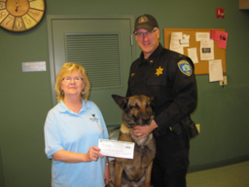 Barbara Jacobs with a Niagara County Sheriff's Department K-9 Unit officer and German Shepherd Officer Taz.