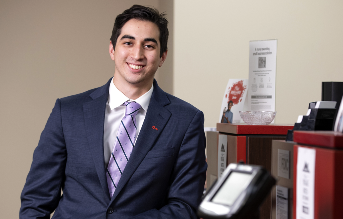 Will Shanahan '20 leans against the counter at KeyBank's South Tacoma branch.