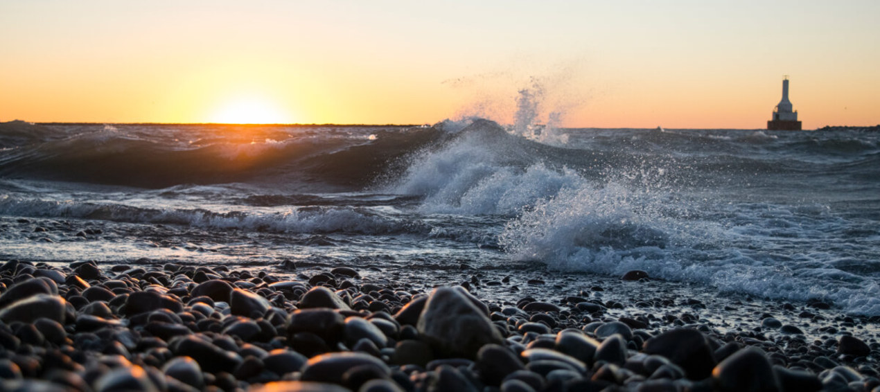 Link to the College of Engineering website featuring the sun setting over Lake Superior at McLain State Park