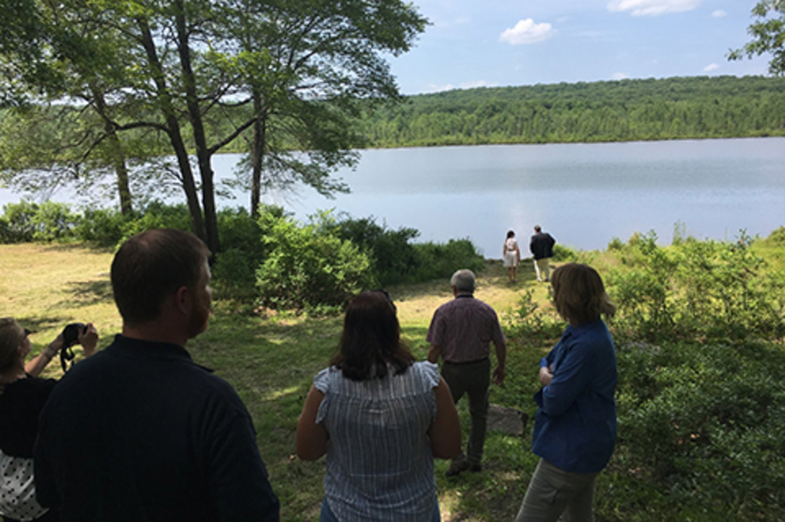 DCNR officials tour the newly aquired property, including the 18 acre lake