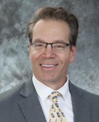 A corporate headshot photo of Ken Levan.