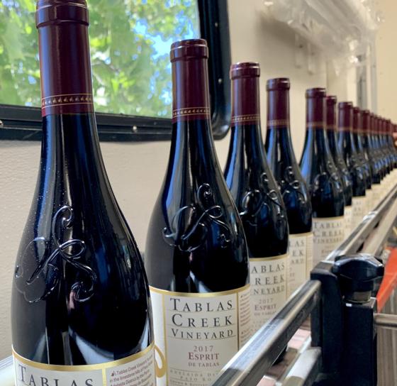 Lighter wine bottles on the bottling line