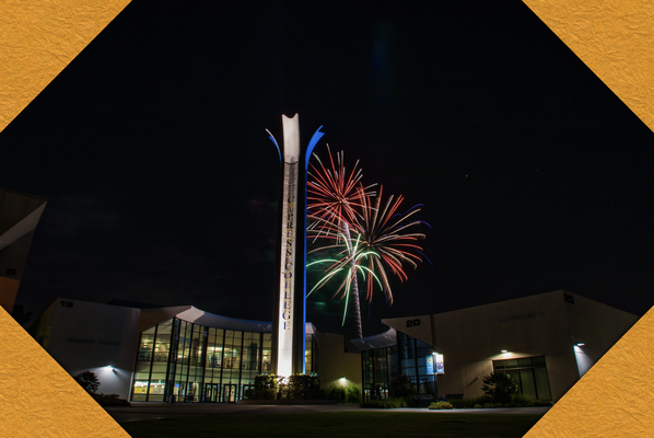 Cypress College campanile and Gateway Plaza with fireworks overhead