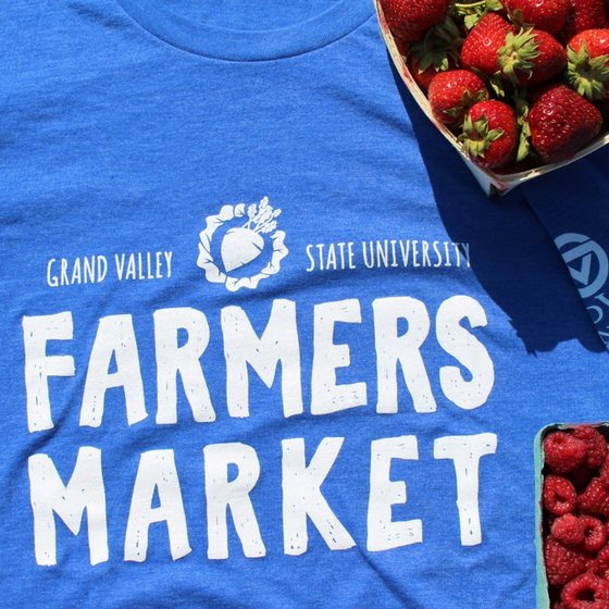 Grand Valley State University Farmers Market, image of t-shirt and strawberries