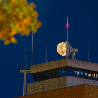 Moon behind the TAMU Aggie Doppler Radar (TAMU-ADRAD). (Photo Courtesy of Stephen Thomas)