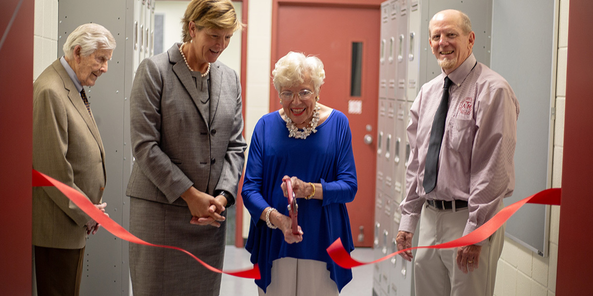 Mrs. Hughes cuts the ribbon for the opening of the Dudley J. Hughes '51 Microscopy Learning Laboratory. (Photo by Chris Mouchyn, Texas A&M Geo