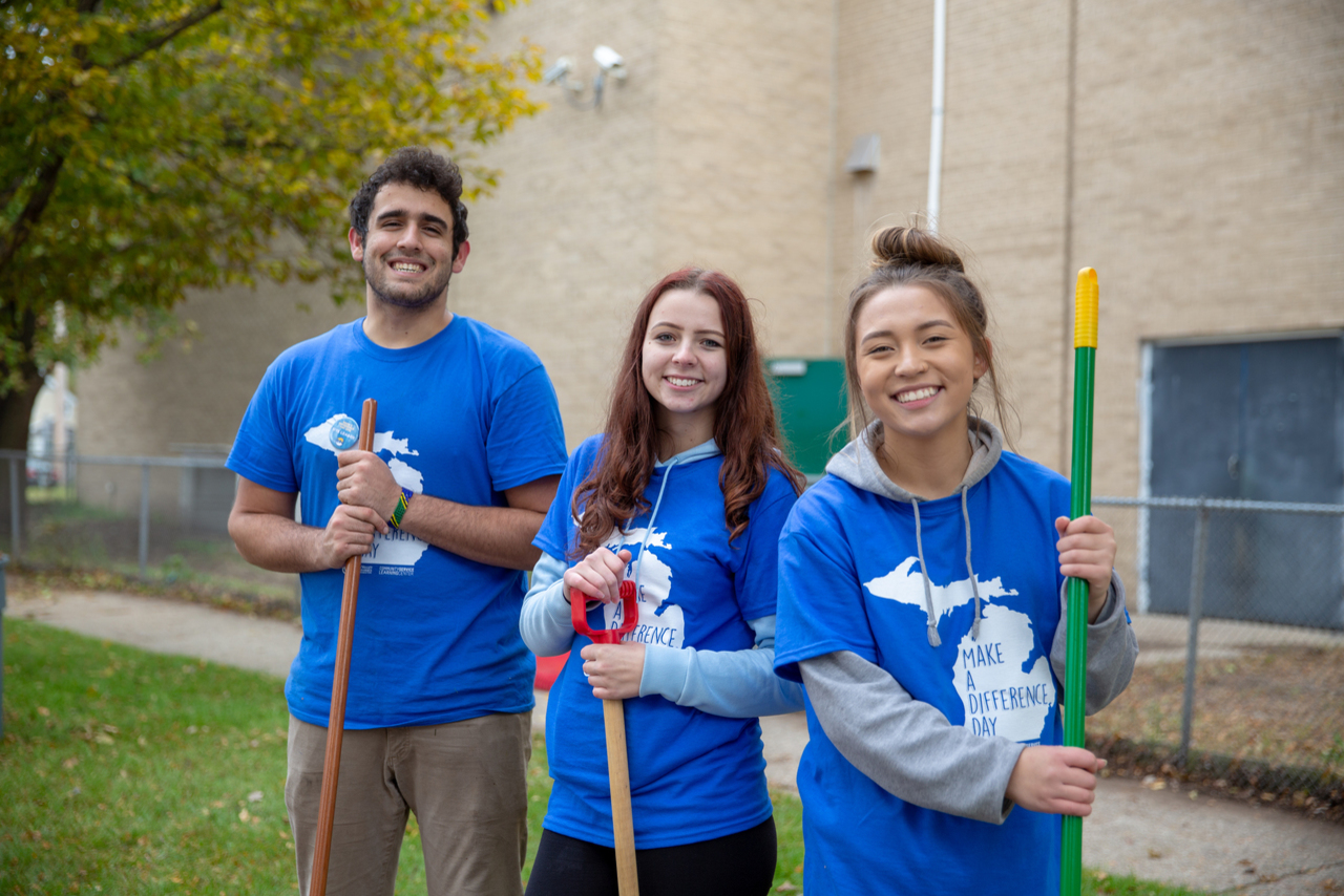 Three students participating in Make a Difference Day.
