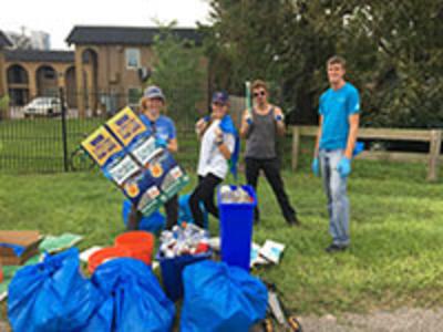 students volunteering outside